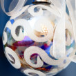 Iridescent christmas ball close-up. - Stock Photo