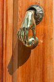 Original door's handle in the shape of a hand — Stock Photo
