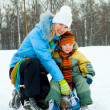 Stock Photo: Mother and son ice skating