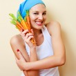 Woman with carrots — Stock Photo