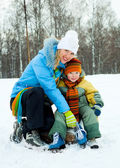 Mother and son ice skating — Stock Photo