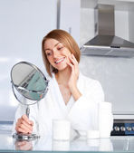 Woman taking care of her face — Stock Photo
