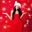 Girl dressed as Santa — Stock Photo #4220513