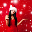 Girl dressed as Santa — Stock Photo #4220520