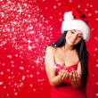 Girl dressed as Santa - Stock Photo