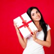 Girl with a present — Stock Photo #4220673