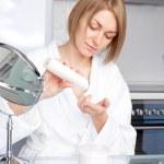 Woman using cosmetics — Stock Photo #4228039