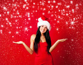 Girl dressed as Santa — Stock Photo