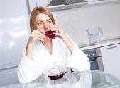 Thoughtful woman drinking tea — Stock Photo