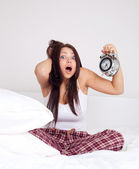 Girl wakes up late — Stockfoto