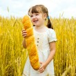 Girl with a long loaf — Stock Photo