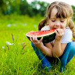 Girl eating watermelon — Stock Photo #4313475