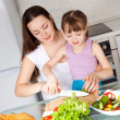 Mother and daughter eat bread — Stock Photo