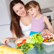 Stock Photo: Mother and daughter cook
