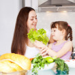 Mother and daughter cook — Stock Photo