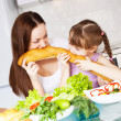 Mother and daughter eat bread — Stock Photo #4427645