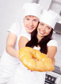 Bakers with bread — Stock Photo