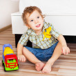 Baby with a toy — Stock Photo #4456473