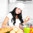 Girl cooking — Stock Photo