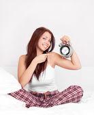 Dívka s budíkem — Stock fotografie
