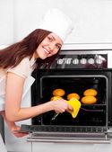 Woman baking bread — Stock Photo