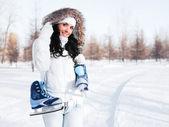 Girl going to ice skate — Stock Photo