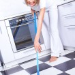Housewife with a mop - Stock Photo