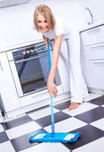 Housewife with a mop — Stock Photo