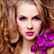Woman with an orchid — Stockfoto