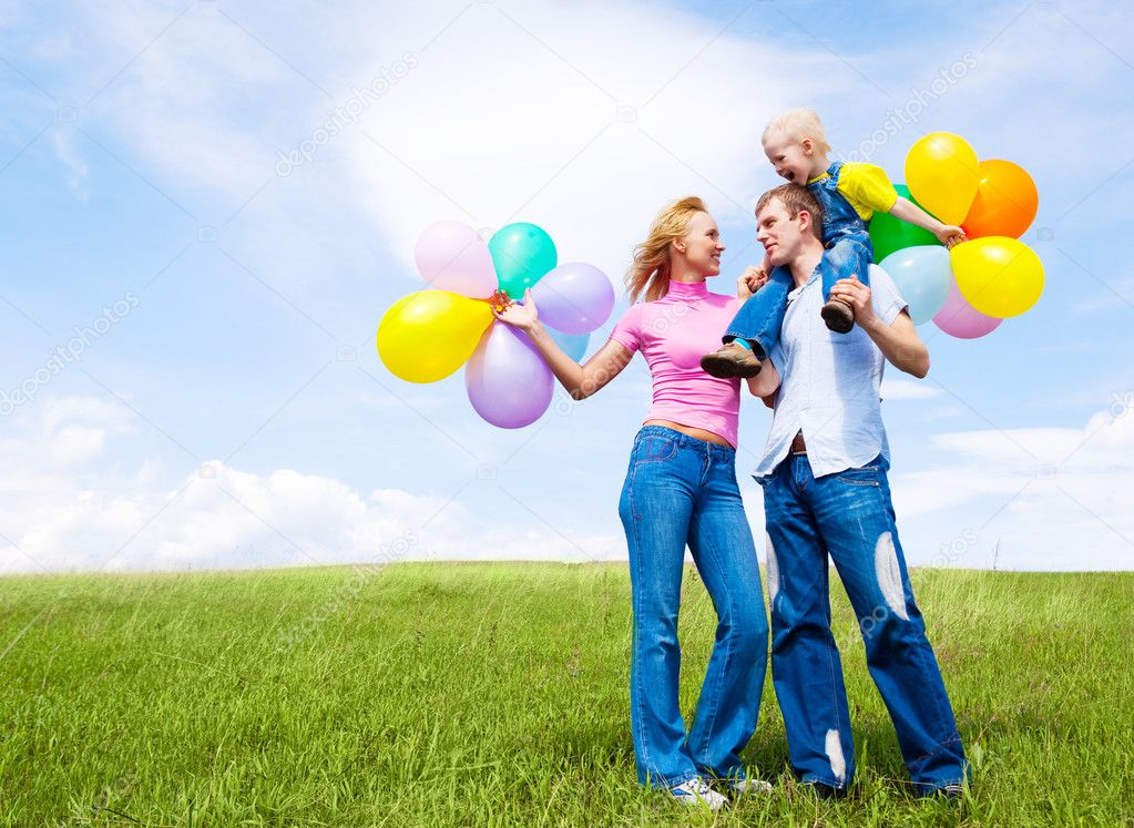 Happy family with balloons outdoor on a summer day — Stock Photo #5168659
