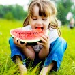 Girl eating watermelon — Stock Photo #5172201