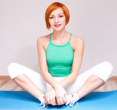 Woman stretching the muscles — Stock Photo