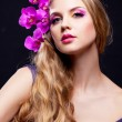Woman with an orchid — Stock Photo