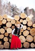Beautiful woman with lumber — Stock Photo