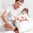 Father feeding daughter — Stock Photo