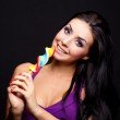Girl with a lollipop — Stock Photo