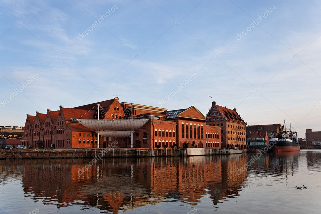The historic building of the Baltic Philharmonic Orchestra with a ship in the background. Gdansk, Poland. — Stock Photo #4916800