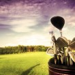 Golf gear, clubs at sunset - Stock Photo
