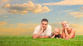 Happy family together on grass — Stock Photo
