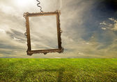 Empty retro frame hanging on poor land — Stock Photo