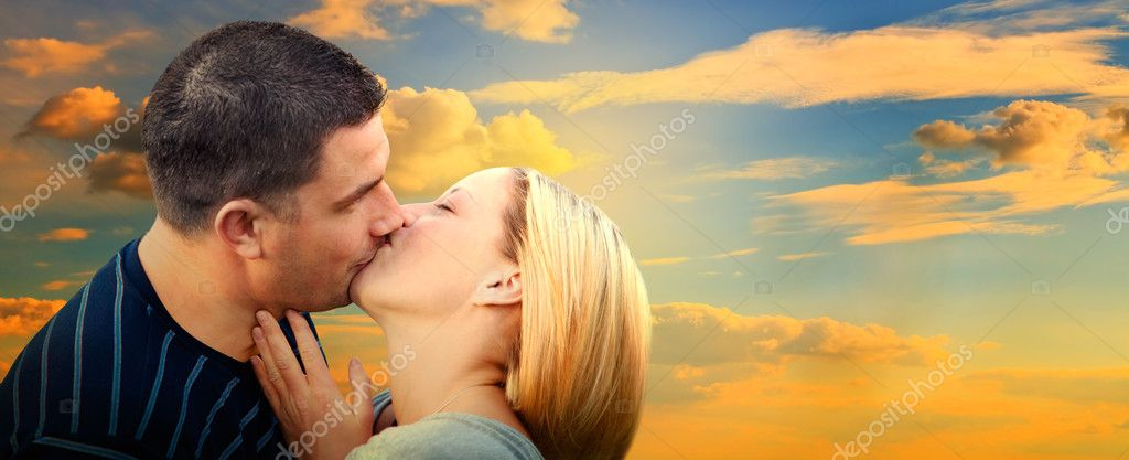 Couple kissing in romantic love scenery on sunset sky. Panorama version — Stock Photo #5201135