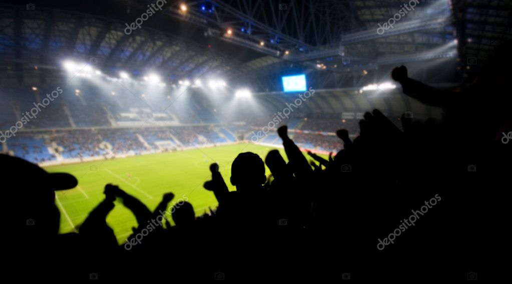 Silhouettes of fans celebrating a goal on football soccer match — Stock Photo #5201193
