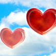 The two red hearts against blue sky — Stock Photo