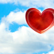 The red heart against blue sky — Stock Photo