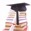 Student hat, diploma and books — Stock Photo