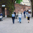 Tourists in the old town Krakow — Stock Photo
