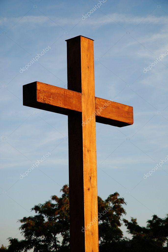 Summer day, cross against blue shining sky  Stock Photo #4050572