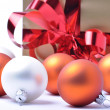 Christmas baubles and gift isolated on white background — Stock Photo #4108071