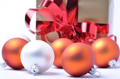 Christmas baubles and gift isolated on white background — Stock Photo