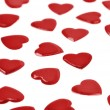Stock Photo: Red hearts confetti on white background